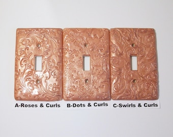Metallic rose gold Swirls and curls light switch covers