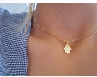 Hand of god charm etsy hamsa gold necklace hand of fatimahand of god gold plated hamsaeye necklace aloadofball Choice Image