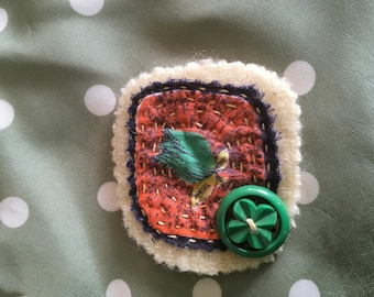 Hand sewn fabric brooch with button