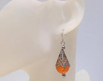 Conical silver orange earrings