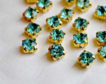 5mm Aqua Glass Sew on Rhinestones. Gold Colored Settings. QTY: 30 Pieces