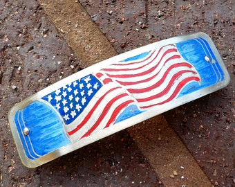 Flag Waving, a large etched silver barrette. Large hand etched and colored metal hair barrette with USA flag design.