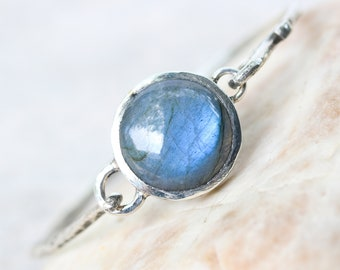 Round cabochon labradorite bracelet in silver bezel setting with oxidized sterling silver with texture band