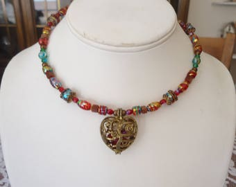 Vintage Red Glass Beaded Memory Wire Choker/Necklace w/ Antique Gold Tone Filigree Heart Cage Pendant Holding Red Glass Stones