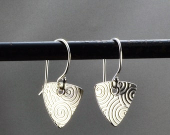 Roller printed sterling silver triangle earrings with 19 gauge Argentium earring wires.