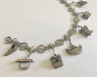 old silver chinese charm bracelet