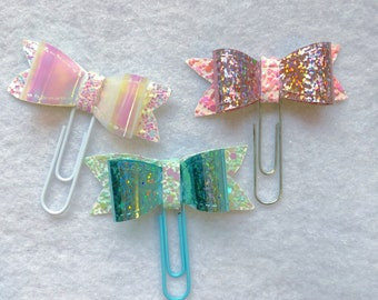 Holographic bows with glitter bases.