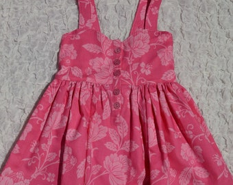 Girls Pink floral button-front peplum top. Size 4