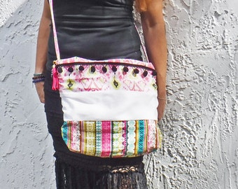 Pompom bag! Spring Ikat/floral boho crossbody. Mixed-print ruched purse with pompom trim and tassel purse charm. Pink, black, white, & teal.
