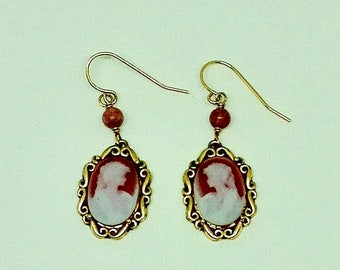 Red agate cameo earrings.