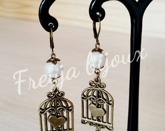 Pearl Earrings white glass Pearl and bronze colored birdcage pendant