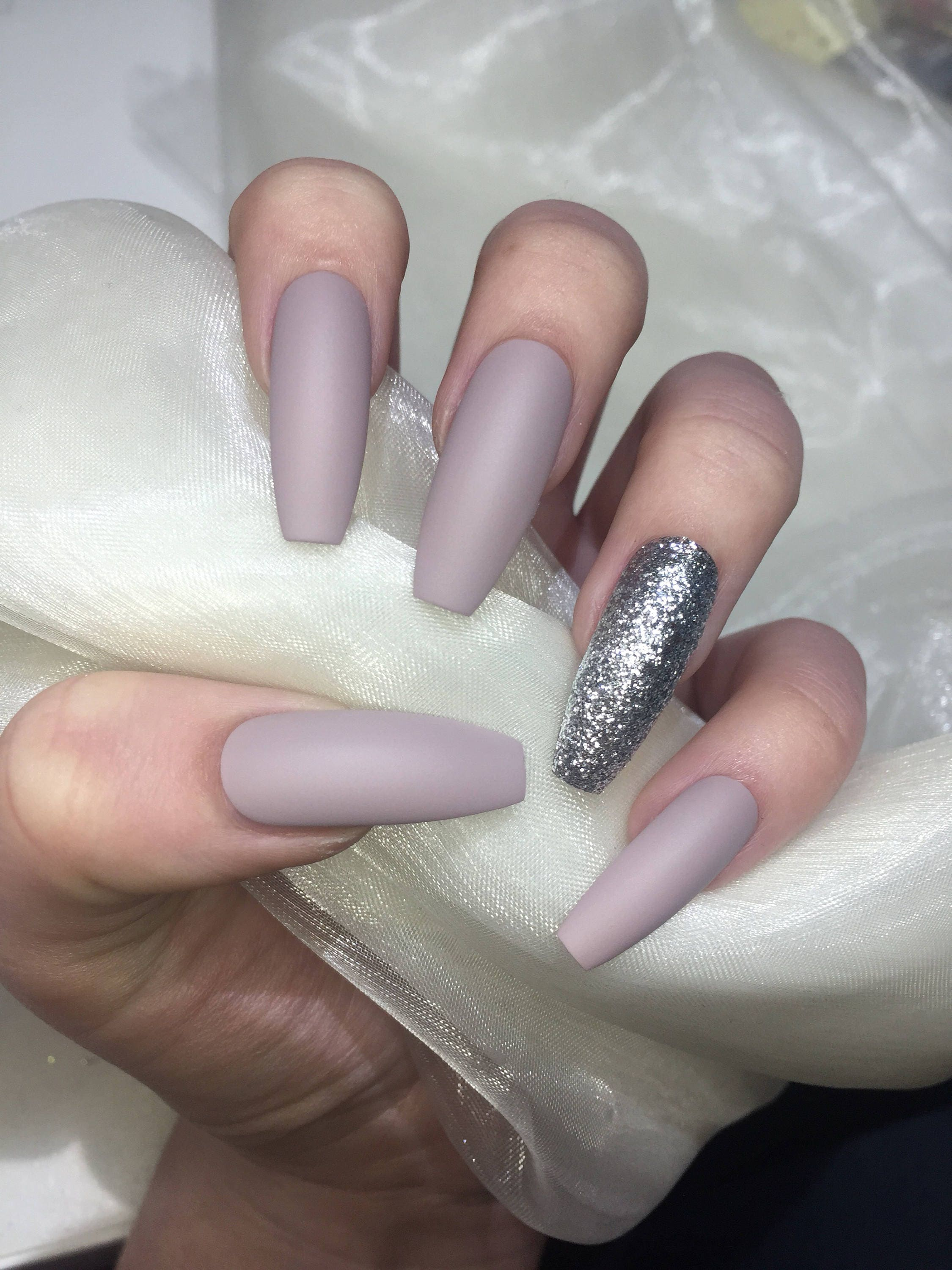 Extra Long Matte Nude and Silver Glitter Coffin False Nails from ...