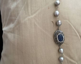 Grey acoya pearls make up this bracelet part sapphire is set in markacite  very nice piece of jewelry