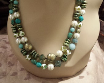 Two strand beaded necklace made with turquoise, fresh water pearl, jade and an assortment of great stones