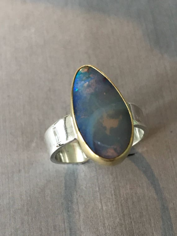 Boulder Opal ring set in 18k gold bezel  sterling silver base and band  size 8.5