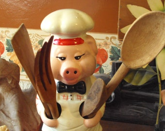 Pig chef with his utensils from the 70s.