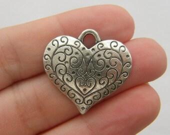 4 Heart pendants antique silver tone H51