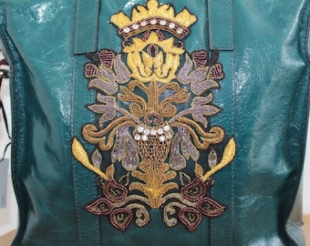 Handbag Grnuine leather from famous brand with embroidered Royal shield. Puel bag with embroidered shield.