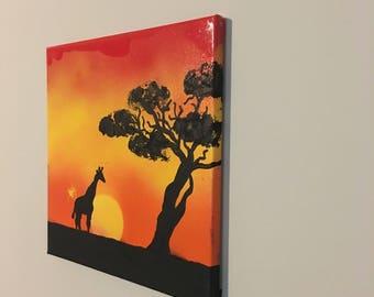 Safari spray painting with giraffe, sunset, and tree