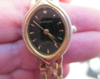 """Lady's watch """"Quemex""""  Quartz, yellow gold  band  black face used watch"""
