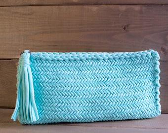 Turquoise clutch with tassel.