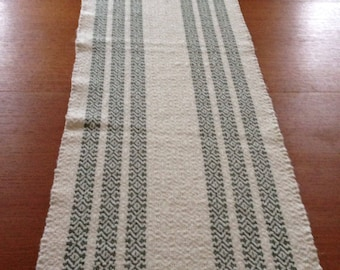 Handwoven table runner, natural with dark green stripes