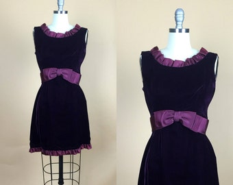 1960s. purple velvet. bow. cocktail dress. with ruffled ribbon trim. small