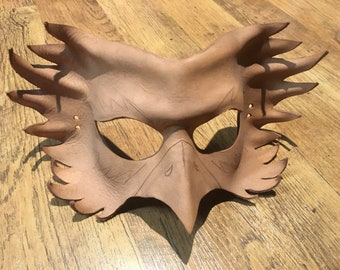 Unfinished leather bird mask