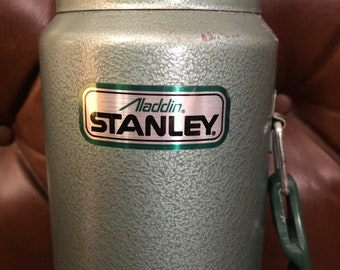 """Happy Camper Aladdin Stanley Thermos Men at Work """"Not all who wonder are lost""""Got it at The Plastic Flamingo """"Some like it Hot"""" or Cold"""