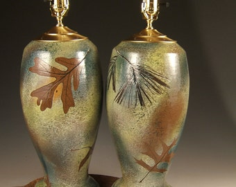 2 ceramic table lamps with shades in green leaf glaze