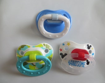 3 Reborn Magnetic or Putty Pacifiers OUR CHOICE of Boy Designs. Doll NOT included. Use Drop Down Menu to Choose Magnet or Putty
