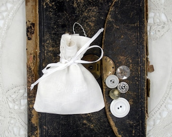 Fabric Bag With Twenty-Five Buttons- White, Clear, and Silver -Toned