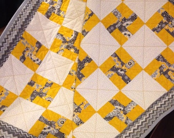 """Whirlygigs In Yellow, Grey and White All Together In This 34.5"""" X 39.5"""" Quilt"""