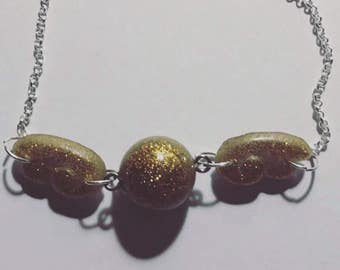 Bracelet with golden snitch