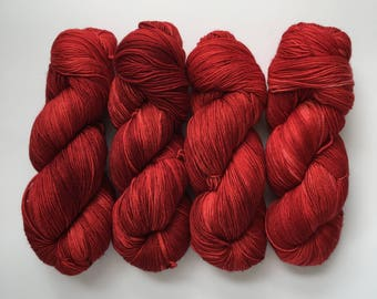 Red carpet treatment - hand-dyed tonal red 4ply sock yarn - 100g