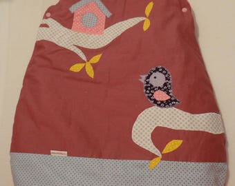 Swaddle baby in shades of plum, pink and yellow