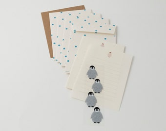 Midori penguin stationery set with letter paper, four patterned envelopes, and four envelope seals