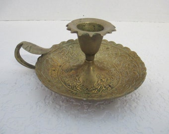 Vintage repeat relief design inside brass finger chamber candle holder used