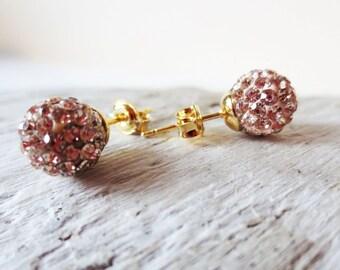 Peach pave earrings. Gold stud earrings. Pave stud earrings. Disco ball earrings. Post earrings. Peach earrings. Crystal earrings.
