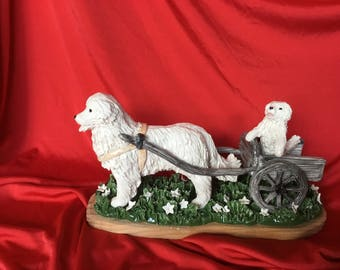 Great Pyrenees dog pulling cart