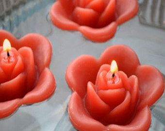 12 Rust burnt orange floating rose wedding candles for table centerpiece and reception decor.