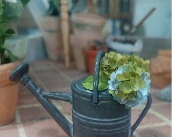 Miniature dollhouse watering can with hydrangeas