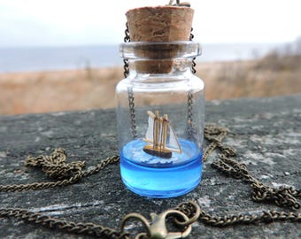Schooner, ship in a bottle, necklace, sailing on a blue sea
