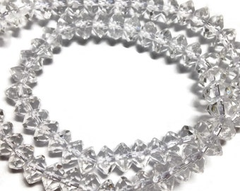 Crystal quartz faceted rondelles, AAA grade.   Select a size: 6-6.5mm, 8mm