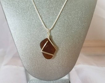"""Sterling silver 18"""" chain with Amber wire wrapped beach glass."""