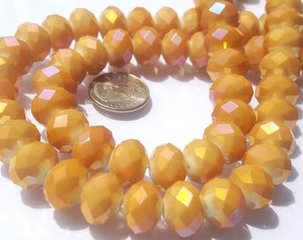 Golden Mystic AB Crystals rondelle beads.Strand 13 inches long.