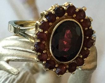 Vintage Garnet Ring. 14 Karat Gold Oval Garnet Surrounded By Ring of Garnets.