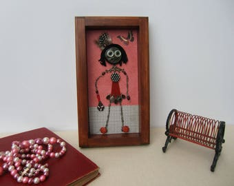 Small unique figurines made of antiques. Wood frame, girl's room.