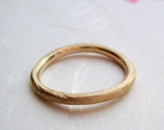 simple rough band in solid 18k yellow gold- mark of the maker- wedding ring