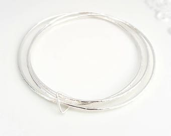 Hammered sterling silver stacking bangles